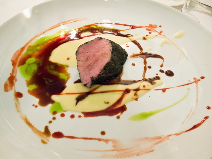 Spin painted veal flame grilled